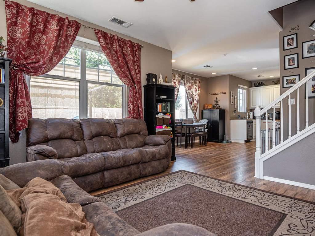 9107-Arbol-del-Rosal-Way-007-006-Living-RoomDining-RoomKitchen-MLS_Size
