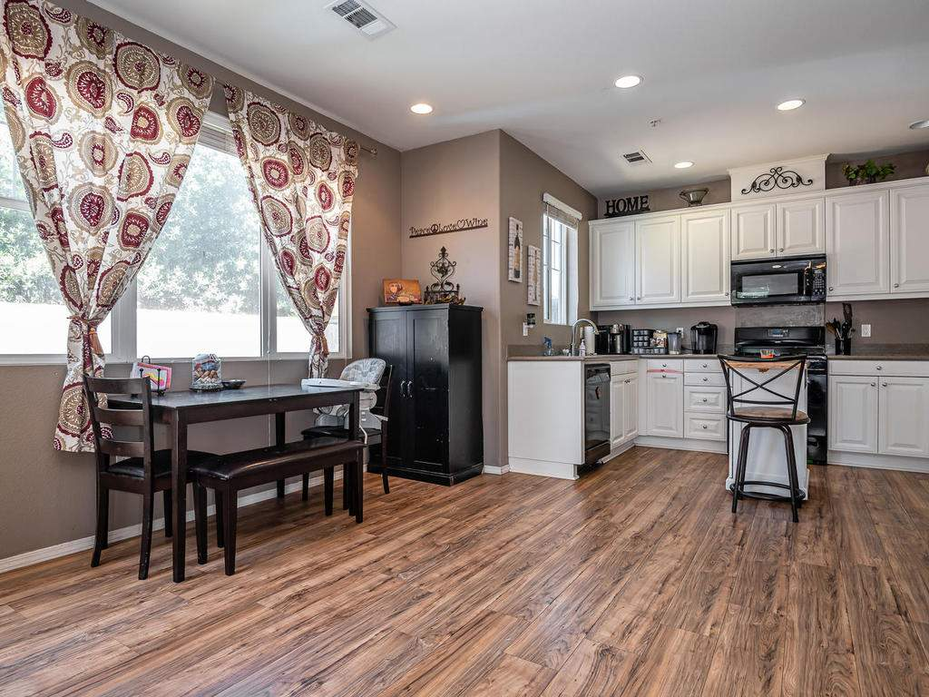 9107-Arbol-del-Rosal-Way-009-008-Dining-RoomKitchen-MLS_Size
